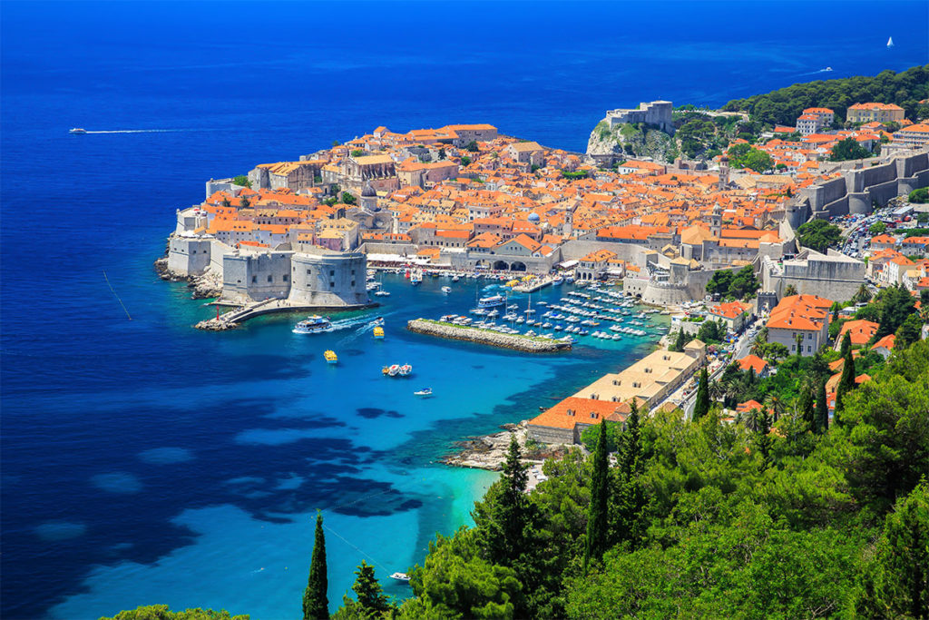 Fortified town Dubrovnik surrounded by the crystal blue sea.