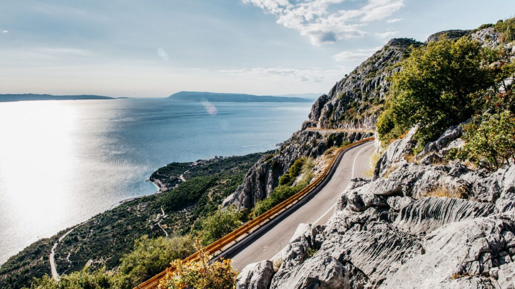 The empty mountain road that overlooks the sea and the island.